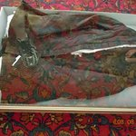 Jacket of Mary Lincoln. It was black, but glass reflected the rug.