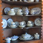 Period china of the day in informal dining area