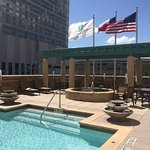 Rooftop pool on 3rd floor with hot tub and moving sculpture overlooking Discovery Green and Geor