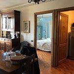 VIEW OF KITCHEN & BEDROOM ENTRANCES FROM FRONT DOOR