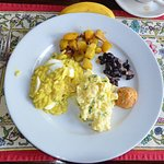 Kedgeree, sauteed potatoes, beans and scrambled eggs