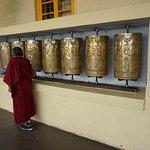 A monk spinning the beautiful prayer wheels