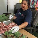 Preparation of Pork LauLau (pork wrapped in taro leaves)