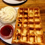 Fabulous Belgian waffle with jam and cream. Great way to start the day!!