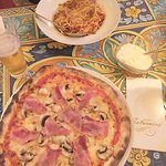 Traditional Spaghetti Bolognese and Ham and Mushroom pizza