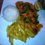 Fish cooked in coconut souce and topped up with shrimps