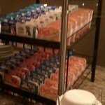 Cereal area: 7 varieties of cereals, bowls, and milk on ice