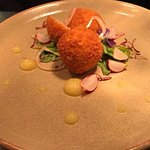 Breaded pork croquettes with caramelized apple puree and radish shavings