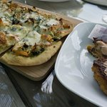 "Chicken, spinach, pesto, artichoke flatbread and Conch ""flitters"""
