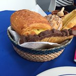 Fruit plate and basket of rolls