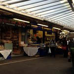 Lots of indoor and traditional outdoor market stalls selling a variety of food and other goods.