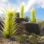 Art Glass exhibit nestled among the cacti