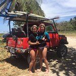 My sister and I after 2 full hours of surfing with Audrey!
