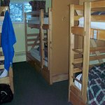 Six bed (three bunk) male dorm.  Lockers under beds and on walls.