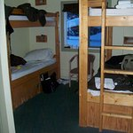 Two bunk (four bed) mixed dorm, with edge of toilet ensuite.