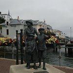 Annie Moore statue in front of Heritage Centre in Cobh