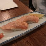 Aburi Sake Harami Nigiri: Seared Tamanian salmon belly nigiri served with Murray river salt and