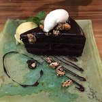 chocolate cake with jackfruit sorbet and caramalised cashew nuts
