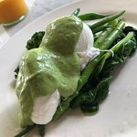 mixed greens with poached eggs and an avocado topping :):)