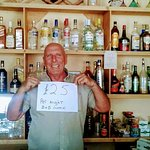 Neil behind the bar.