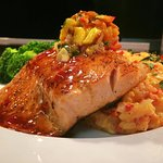 Salmon topped with fresh mango salsa and cheddar risotto