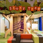 The Story Tree offers nooks and crannies for reading, make believe, and putting on a show.