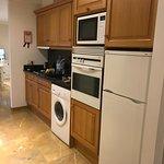 kitchen area with fridge freezer and washing machine