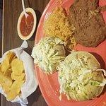 Puffy Tacos with carnitas and cabbage.