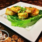 Wham pow, our fried shrimp appetizer with a spicy asian sauce over  leaf lettuce