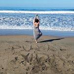 enjoying a few sun salutations on Jaco Beach