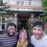 With the hotel owner celebrating Holi