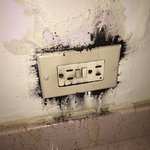 Outlet in bathroom at Caribe Hilton.