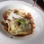 A partly eaten short rib ravioli