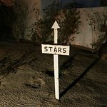 A playful sign direct the eye upwards for fabulous star-gazing.