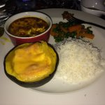 Chicken in a berbere sauce, roasted squash, mixed vegetables, rice