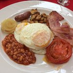 Breakfast: Fried egg, sausage, sauteed mushrooms, streaky bacon, fried tomato, onion