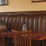 """a large empty booth right behind were we sat...we were told that they had to """"save it"""" for ?"""