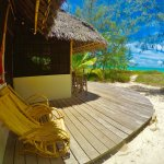 Relax on the private veranda of the Turtle Bungalow, only steps away from the beach.