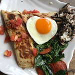 3 cheese crepe with fried egg and side of sautéed spinach and mushroom