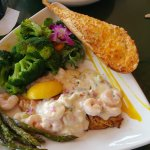 smothered grouper with boccoli and asparagus