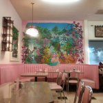 Hand painted mural, pink leather banquettes, flormica tables.