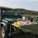 Breakfast in the Mara.  They think of everything.  That is Joash, our wonderful driver, in the g