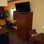 """Suite with 1 Queen Bed Work Area with 42"""" HDTV, 1 Cup Coffee Maker, Micro/Fridge, Kitchenette"""