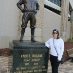 Daughter with Knute Rockne statue by the Rockne north gate.