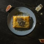 Phyllo; wrapped feta cheese with honey and sesame seeds