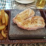 pork meat on a hot stone (chicken and beef is available)