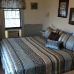 The Elderberry Suite. King Bed with loft double bed. Kitchenette, mini-fridge, sitting area, Keu