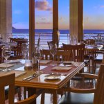 Enjoy ocean views & Guam's iconic sunsets over Tumon Bay from window seating or balcony dining.