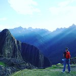 Sun-rays over the mountains at Machu Picchu