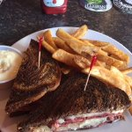 Reuben sandwich and fries with a side of tartar sauce
